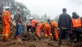 Rescue workers search for survivors at the site in Sichuan province