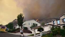 Aggressive wildfire threatens homes in California city