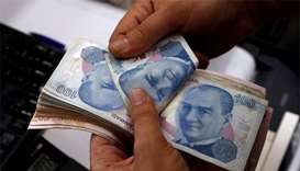 Turkish lira plunges 14% on worries over economy, US row