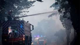 Portugal puts out Algarve fire, firefighters keep vigil