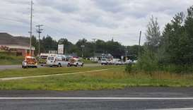 Emergency vehicles are seen at the Brookside Drive area in Fredericton, Canada