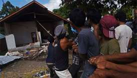Indonesia quake death toll tops 400 as more bodies recovered