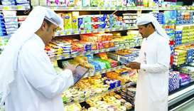 MME officials at work in the dairy products section of a shop.