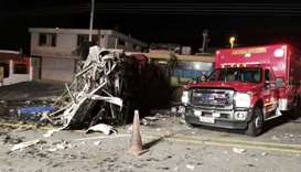 Photo released by the Fire Brigade of Quito showing an ambulance at the scene of an accident where a