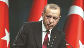 Erdogan: Turkey will boycott US electronics; lira steadies