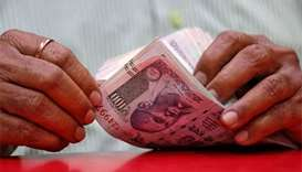 Indian rupee touches record low as Asia markets tumble