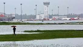 A man walks inside the flooded Cochin international airport