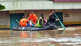 Indian navy and rescue personnel evacuate local residents in an boat at Aluva