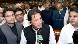 Imran Khan (C), chairman of Pakistan Tehreek-e-Insaf