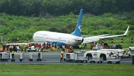 Chinese jet slides off Manila airport runway in heavy rain