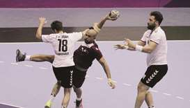 Qatar top group with win over Iran