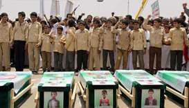 Yemeni children vent anger against Riyadh and Washington as they take part in a mass funeral in the