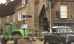 Tractor used to rip cash machine off shop wall