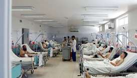 Afghan men who were injured in a recent attack in Kabul and Ghazni province, receive treatment at a