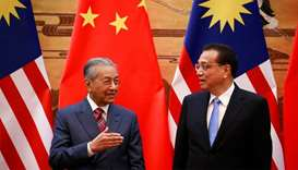 Malaysia's Prime Minister Mahathir Mohamad and China's Premier Li Keqiang