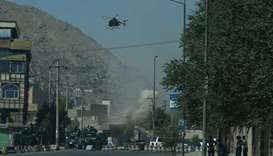 Smoke and dust (C) rise following an air strike from an Afghan military helicopter during ongoing cl