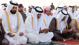 His Highness the Amir Sheikh Tamim bin Hamad Al-Thani performs Eid Al Adha prayer along with a group