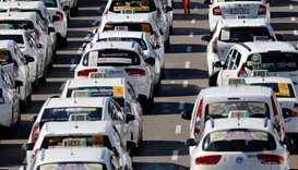 Taxis block a section of the main avenue Paseo de la Castellana in Madrid
