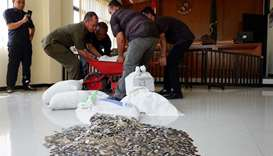 Indonesian man pays $10,000 to ex-wife... in coins