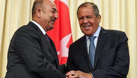 Russian Foreign Minister Sergei Lavrov (R) shakes hands with his Turkish counterpart Mevlut Cavusogl