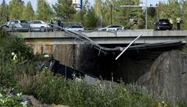 Four killed, 20 hurt as bus plunges off bridge in Finland