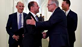 Incoming Australian Prime Minister Scott Morrison is congratulated by his new deputy Josh Frydenberg