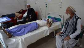 Afghan victims receive treatment at a hospital following a suicide attack in Jalalabad