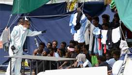 Italy allows some migrants off stranded boat amid EU row