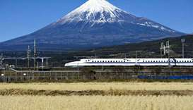 Japan bullet train staff made to sit by tracks