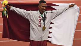 Qatar's Abubaker Abdalla celebrates during the victory ceremony for the men's 800m