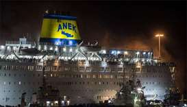 Greek passenger ferry docks at Piraeus port after fire