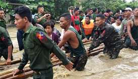 Dam breach floods communities in Myanmar, blocks highway