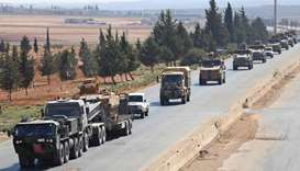 Turkish forces are seen in a convoy on a main highway between Damascus and Aleppo