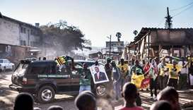 Supporters of the newly reelected Zimbabwe President Emmerson Mnangagwa celebrate in Mbare, Harare.