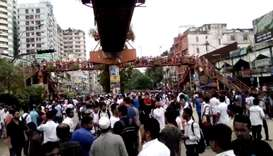 People and students protest over recent traffic accidents that killed a boy and a girl, in Dhaka, Ba