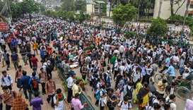 Bangladeshi students block a road during a student protest in Dhaka