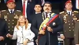 Venezuelan President Nicolas Maduro (C), his wife Cilia Flores (L) and military authorities