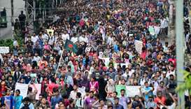 Bangladeshi students march along a street during a student protest in Dhaka
