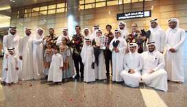 Qatar bowling team return to a warm welcome