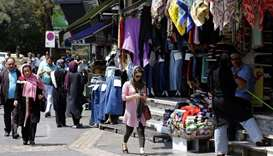 People walk in a shopping street in the Iranian capital Tehran