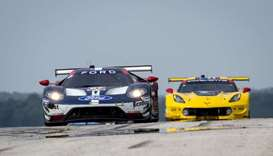 #67 Ford GT of Richard Westbrook, UK, and Ryan Briscoe, Australia, leads another car onto pit road