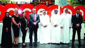 Ooredoo COO Yousuf Abdulla al-Kubaisi and Mall of Qatar CEO Stuart Elder flank other dignitaries dur