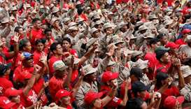 Militia members and supporters of Venezuela's President Nicolas Maduro attend a rally in support of