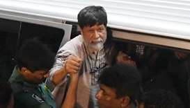 Bangladeshi policemen arrive with activists and photographer Shahidul Alam for an appearance in a co