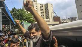 Renowned Bangladeshi photographer Shahidul Alam, 63, gestures in a hospital in Dhaka