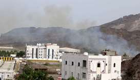 Smoke rises during clashes in Aden, Yemen