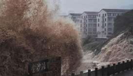 Typhoon in eastern China causes landslide, killing 18 people