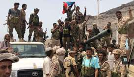 Yemeni supporters of the southern separatist movement pose for a picture in Khor Maksar, Aden