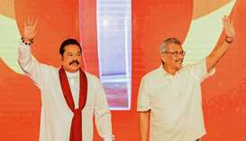 Sri Lanka's opposition leader and former president Mahinda Rajapakse (L) and his brother, Gotabhaya