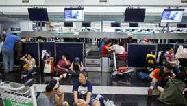 Hong Kong airport grinds to halt; China likens protests to terrorism
